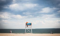 May 23, 2015: A Belarusian woman studying English in lifeguard chair at Coney Island