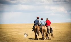 Aug 20, 2015: Kyrgyz Youth Riding into Distance