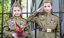May 9, 2015: Two Girls at Victory Day Parade in Moscow