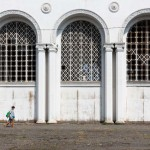 A woman walking by the train station in Sukhumi.