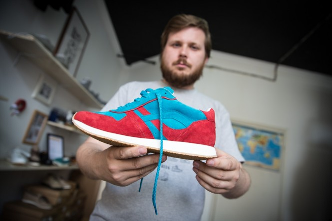 AFOUR owner Vladimir, 31, showing off one of the hand-made sneakers.