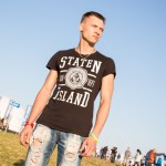 Maxim, 22, is a machinist from Nizhny Novgorod. He was playing freebie at the Alfa Future People concert in his Staten Island shirt.