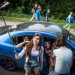 Russian youth taking the opportunity during a traffic jam outside the concert premises to take some selfies.