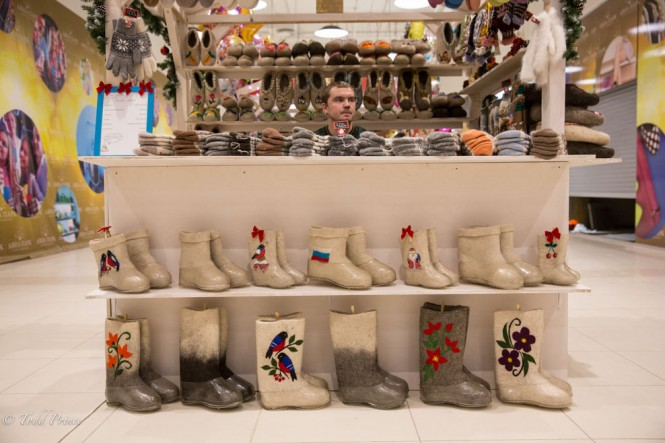 A man selling Russian-styled winter boots and socks.