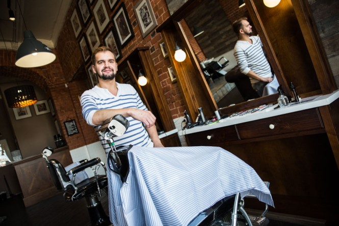 Valery has been working as a barber for nearly a decade. He says men are starting to take a greater interest in their looks and hairstyles.