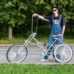 Andrei, 35, was relaxing along Vorobyovskaya Naberezhnaya in Moscow after a ride on his chopper bicycle. He was wearing a Yankees hat.