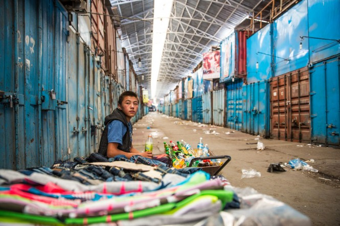 A child worker at the Dordoy market in Bishkek, Kyrgyzstan