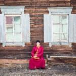 Ochar, a Buddhist student, sitting in front of his dormitory.