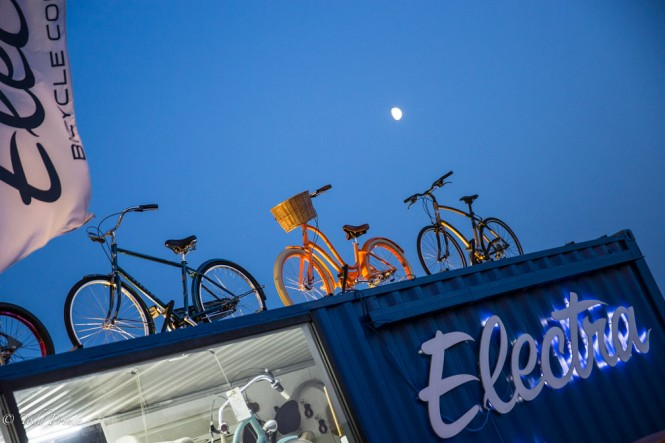 The moon looking down upon Electra bicycles outside a Moscow mall.