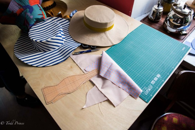 Hats and drawings scattered on Sergei's desk.