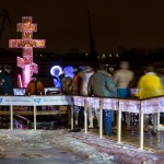 A cross stands next to the ice hole on the Moscow River on the eve of Epiphany.