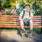 This teenager was rollerblading while at Gorky Park on a sunny Friday evening wearing a New York t-shirt. He said the TV serial Californication comes to mind when he thinks of New York.