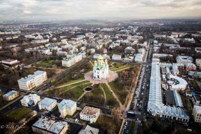 A church standing in the center of a square in the St. Petersburg suburbs.