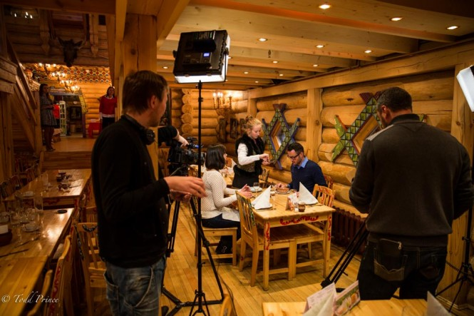 The cameramen getting the lighting set up as we prepare to eat the borscht we cooked on the TV program.