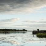 Fisherman along the Onega River in Kargopol at sunset.