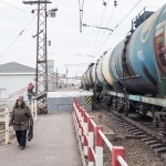 Oil Rail Cars whizz by Kolomna train station.