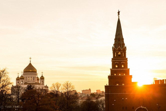The sun throwing its last rays for the day over the Kremlin wall. Christ the Saviour Church stands to the left.