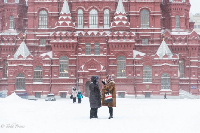 Two women talk a minute to talk on Red Square amid yesterday's storm.