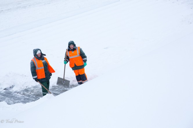 Two women, both city workers, taking a short break as they clear the heavy snow fall.