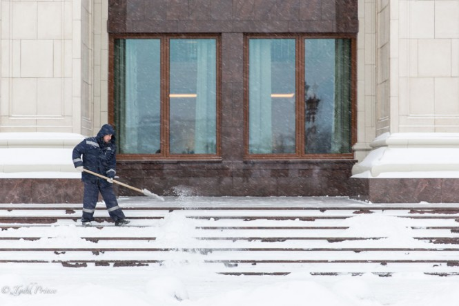 A worker clearing snow in front of the Four Seasons Hotel near Red Square.