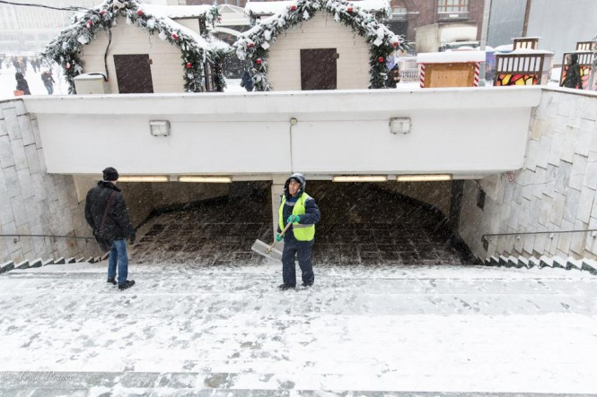 A migrant worker cleaning the metro entrance near Red Square.