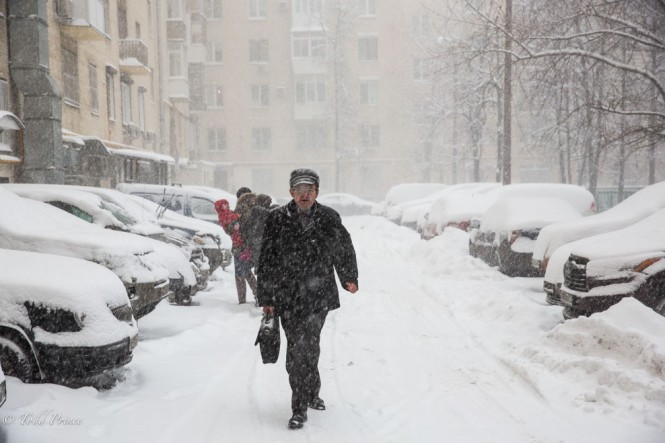 A Muscovite on his way to work during yesterday's storm.