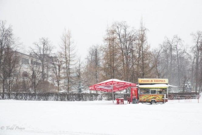 A food kiosk stands amid the snow.