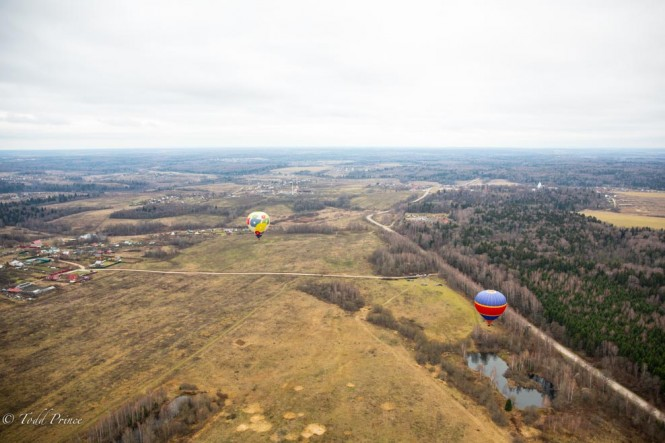 Two hot air balloons follow us over the Moscow suburbs.