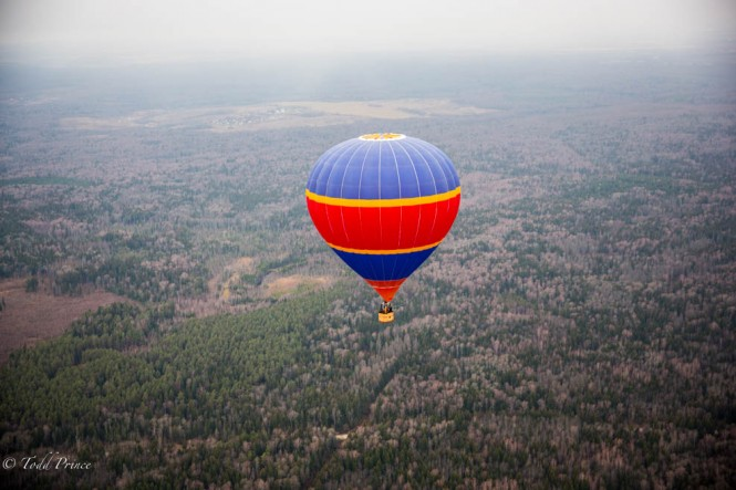A hot air balloon flying over the forests outside Moscow.