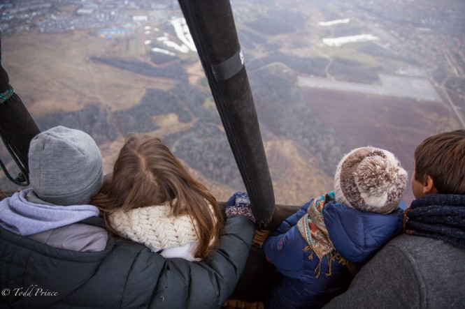 Two young couples enjoying the view from the hot air balloon.