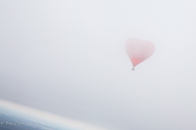 The romantic balloon drifts into the clouds.