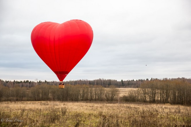 Aeronavt offers a 'romantic' ride in a red, heard-shaped hot air balloon. Here it is taking off.