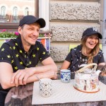 Alexander and Anna in their New York hats on St. Petersburg 'hipster' street Rubenshtein