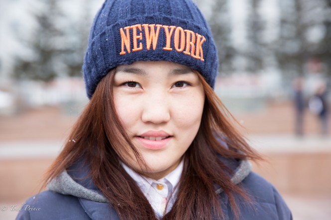 Medegma, 18, was wearing her New York winter hat while waiting for a bus in Ulan-Ude near the largest Lenin head in the world. She wants to join the armed forces.
