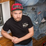 Artem, dressed in a Brooklyn hat and shirt, runs a clothing store in St. Petersburg called Brooklyn.