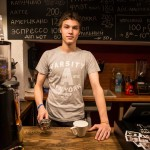 Alexei was wearing a NYC shirt under an apron as he made coffee at a Moscow cafe.