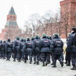 Police walking by the Kremlin on Red Square.