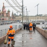 Workers cleaning the bridge where Nemtsov was killed ahead of the rally.