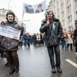 Two men carrying a photo of Nemtsov.