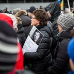 A woman carrying a photo of Nemtsov during the rally.