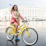 Serafima riding her bike across Nevsky after a short rainstorm.