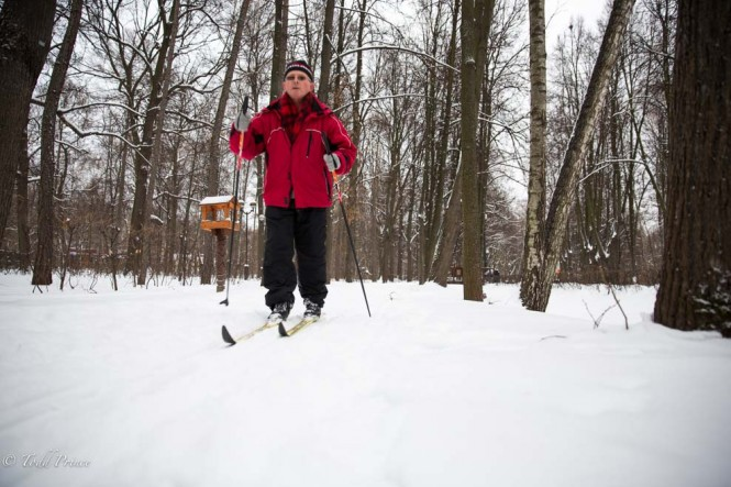 A man cross country skiing through a park on New Year's Day.