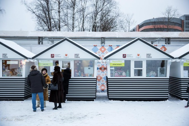 Russians standing on line at a kiosk in Izmailovsky Park for pancakes on New Year's Day.