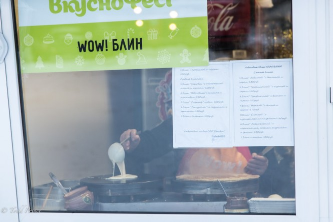 A Russian woman making pancakes at a kiosk in Izmailovsky Park in Moscow on New Year's day.