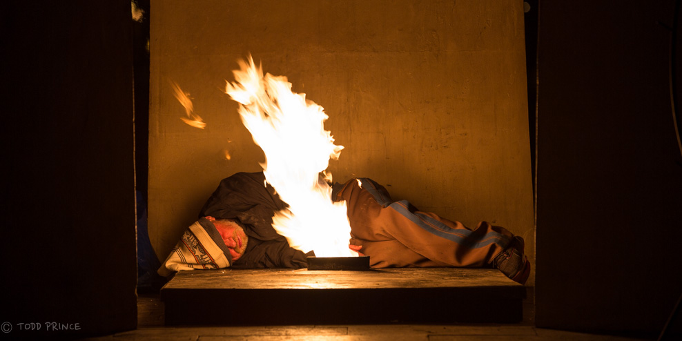 Homeless Man Sleeping Next to Eternal Flame on New Year's Night