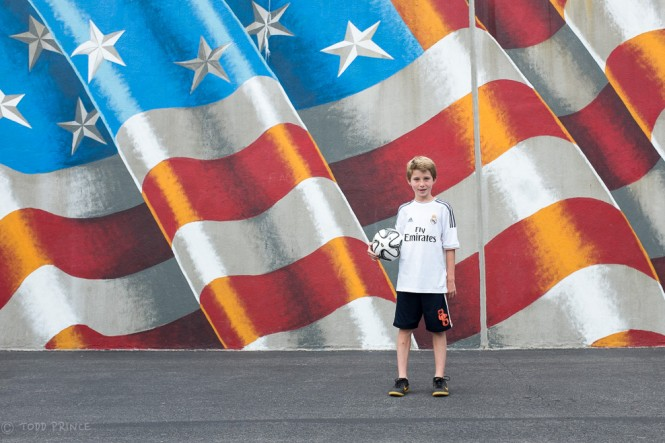 A huge US-flag painted on a handball wall on the premises of a public school on my block in Brooklyn.