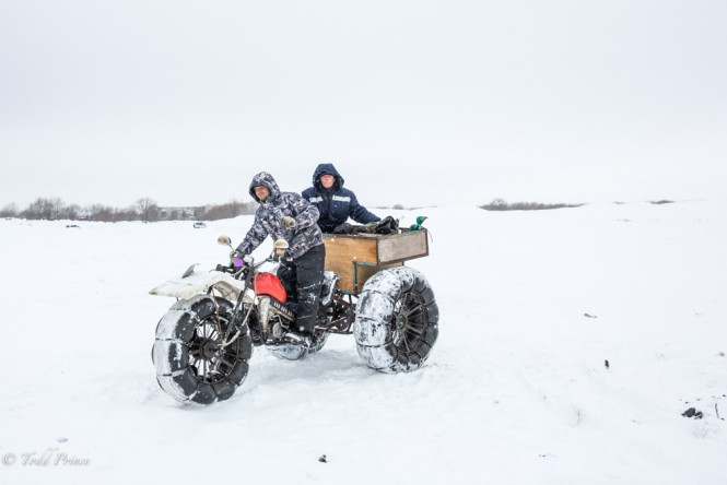Two Russians riding on a motorcycle on Sakhalin