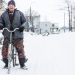 A fisherman biking home on the icy roads.