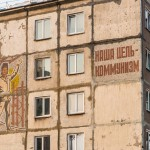 ''Our goal is communism,'' read the sign on this old residential building in Yuzhno-Sakhalinsk.