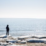A man looking out onto the sea off Sakhalin.